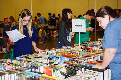 Ladies Looking Through Books